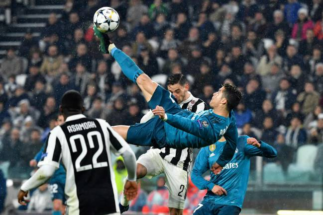 Real Madrid's Portuguese forward Cristiano Ronaldo scores in Turin.