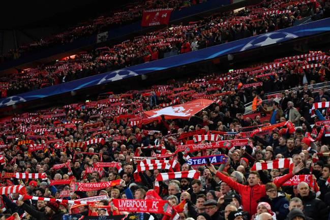 Liverpool supporters cheer during the UEFA Champions League first leg quarter-final football match between Liverpool and Manchester City, at Anfield stadium.