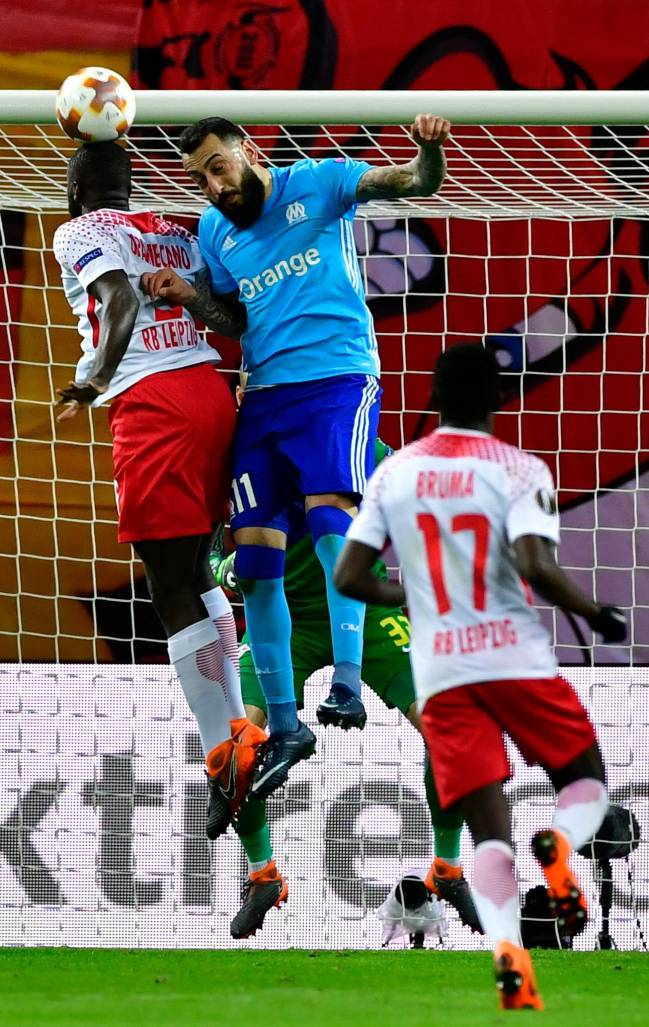 RB Leipzig's French defender Dayot Upamecano goes up against Marseille's Greek forward Konstantinos Mitroglou in the Uefa Europa League quarter-final first leg.