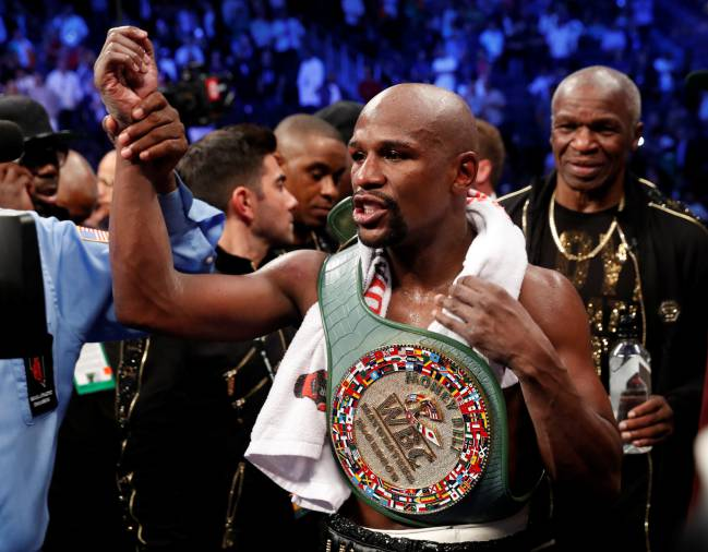 Floyd Mayweather Jr. celebrates with the belt after winning the fight against Conor McGregor in Las Vegas, Neveda, U.S., August 26, 2017.
