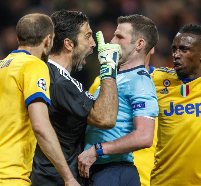 Buffon overstepping the mark with referee Oliver.