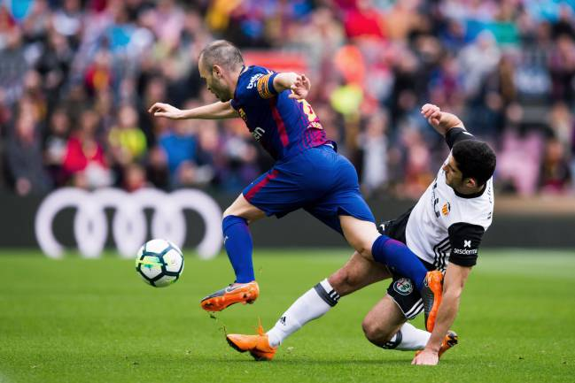 Still got it | Goncalo Guedes of Valencia CF tries to tackle Andres Iniesta of FC Barcelona.