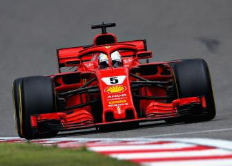 Vettel snatches pole from Raikkonen as Ferrari dominate