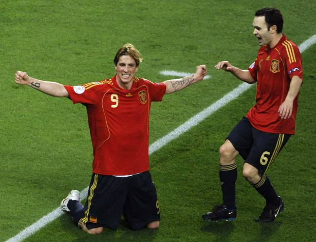 Another moment | Spain's Fernando Torres celebrates with Andres Iniesta after scoring during their Euro 2008 final against Germany.