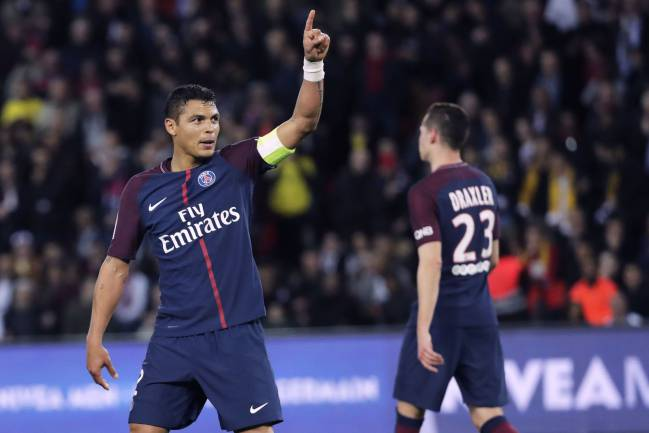 Paris Saint-Germain's Brazilian defender Thiago Silva celebrates.
