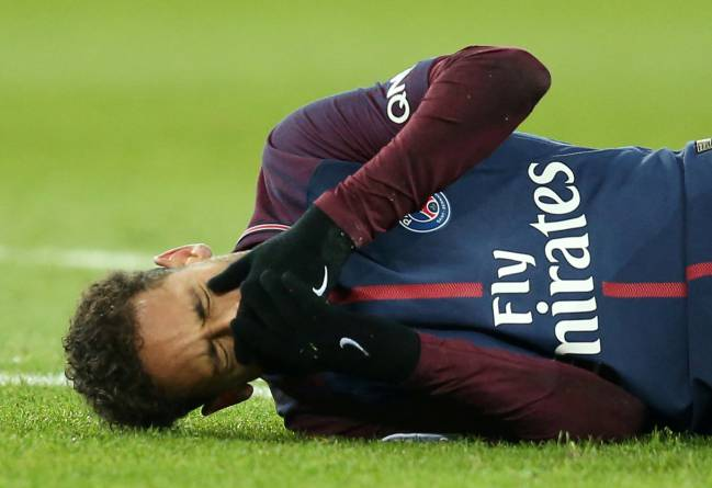 Paris Saint-Germain's Neymar lies on the pitch after sustaining an injury, and speculation is rife that he may also be looking for a way out of PSG.