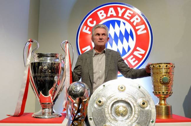 More please | Bayern Munich's head coach Jupp Heynckes posing with the UEFA Champions League, the German Football Cup (DFB-Pokal), the Super Cup and the Bundesliga German League trophies.