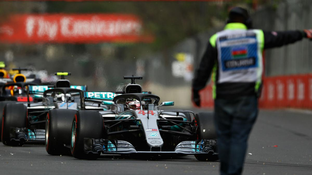 Hamilton handed unlikely triumph in dramatic Baku finale