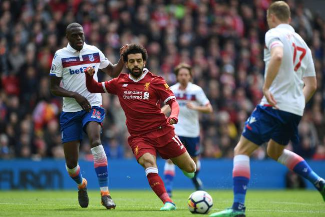 Liverpool's Egyptian midfielder Mohamed Salah vies with Stoke City's Portuguese-born Dutch defender Bruno Martins Indi.