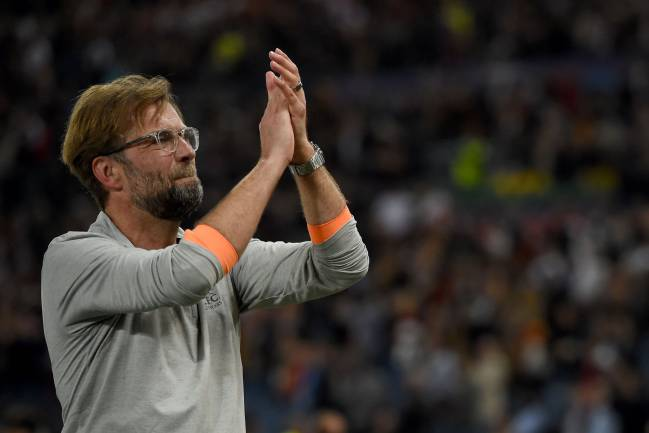 Keeping them on edge | Liverpool manager Jürgen Klopp applauds the fans following the UEFA Champions League semi-final second leg in Rome.