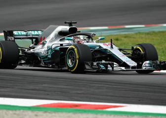 Lewis Hamilton triumphs in tense battle for Spanish GP pole