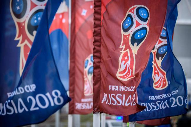 Russian hosts | Flags featuring the logo of the FIFA World Cup 2018 are seen outside Rostov Arena in the southern Russian city of Rostov-on-Don.