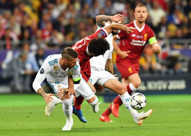 Sergio Ramos brings down Mohamed Salah in yesterday's Champions League final in Kiev.