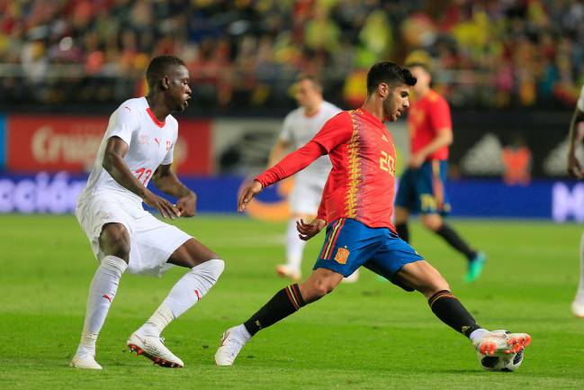 Reporting for duty | Spain's Asensio in action against Switzerland.