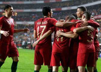 Guedes grabs brace as Portugal ease past tame Algeria