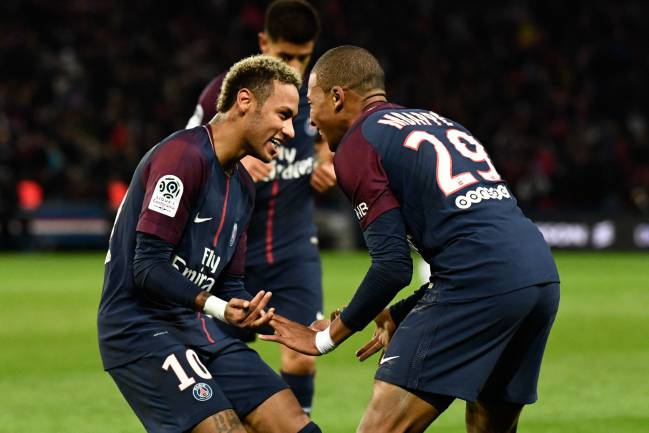Another season of this | Paris Saint-Germain's Brazilian forward Neymar and French forward Kylian Mbappe celebrate.