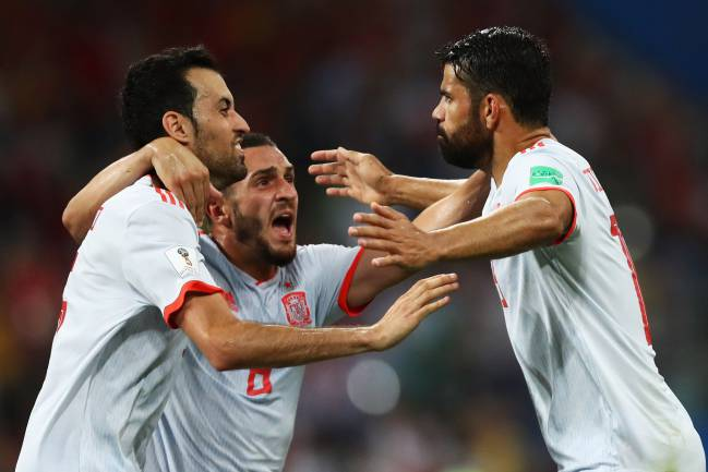 Diego Costa of Spain celebrates with team mates after scoring his team's second goal during the 2018 FIFA World Cup Russia group B match against Portugal.