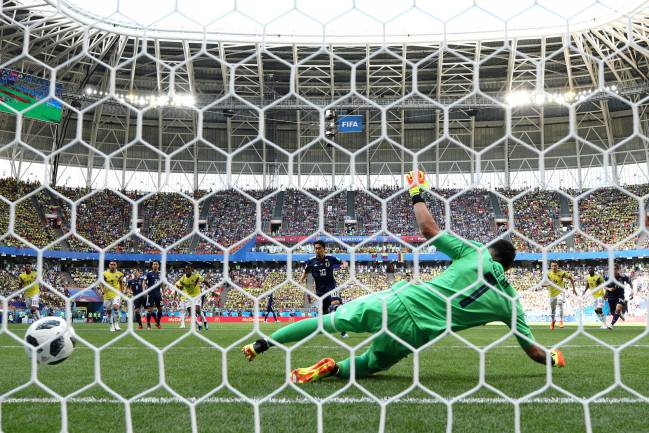 Shinji Kagawa strokes home a penalty during the 2018 FIFA World Cup Russia group H match between Colombia and Japan