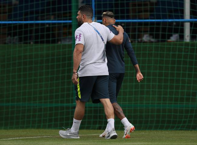 Neymar Jr leaves training with the physiotherapist Bruno Mazziotti during a training session at Yug-Sport Stadium on June 19, 2018 in Sochi.