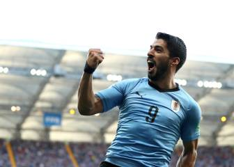 Uruguay, Russia into last 16 as Suárez sees off Saudi Arabia