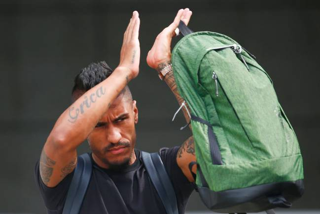 Brazil's midfielder Paulinho leaves his team's hotel in Kazan on July 7, 2018, a day after the five-time champions crashed out of the Russia 2018 World Cup.