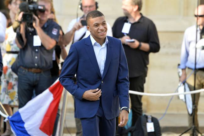 Honoured | Kylian Mbappe arrives as French President Emmanuel Macron receives the France football team during a ceremony at the Elysee Palace.