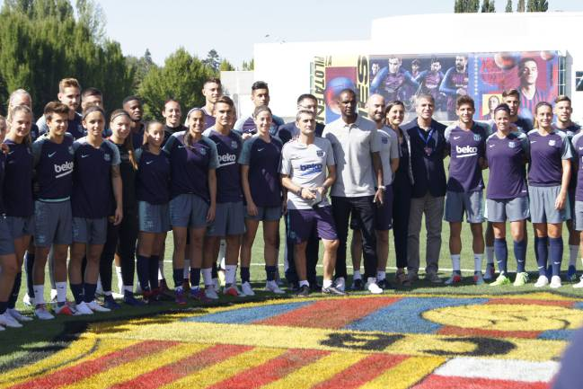 FC Barcelona's male and female players train together in Portland, USA.