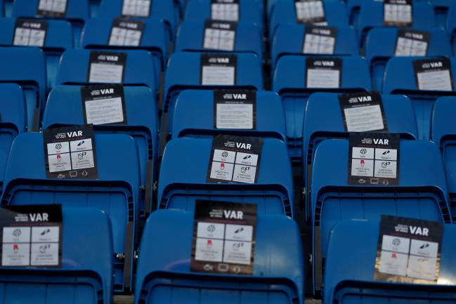 Santiago Bernabeu, Madrid, Spain - August 19, 2018 | General view of leaflets on stadium seats explaining VAR.