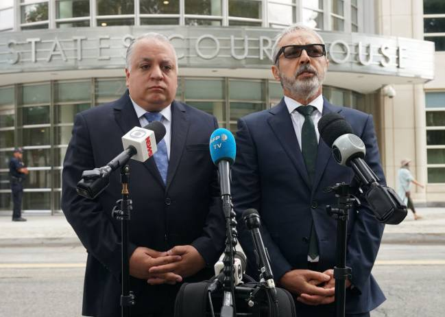 Paulo Peixoto (L) and Julio Barbosa (R), attorneys for Jose Maria Marin, the former head of the Brazilian football federation, speak outside court August 22, 2018 in New York.