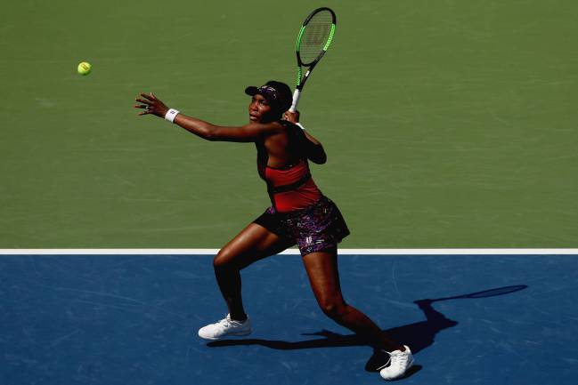 Venus Williams in action against Camila Giorgi on Day Three of the 2018 US Open.