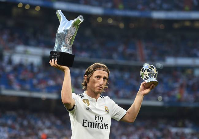 Luka Modric of Real Madrid celebrates with his 2017/18 UEFA Men's Player of the Year award.