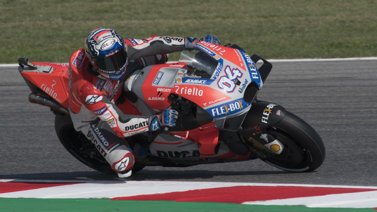 Dovizioso triumphs as Lorenzo crash hands Marquez second