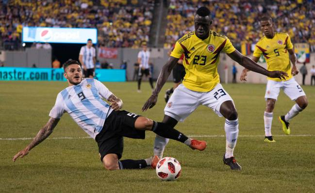Argentina's foward Mauro Icardi vies for the ball with Colombia's defender Davinson Sanchez.
