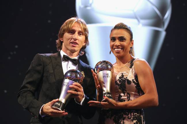 Luka Modric and Marta pose for a photo with their awards during The Best FIFA Football Awards.
