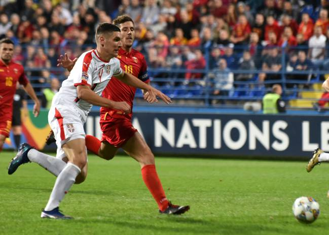 Nikola Milenkovic and Stevan Jovetic chase the ball in last night's UEFA Nations League game between Montenegro and Serbia in Podgorica.