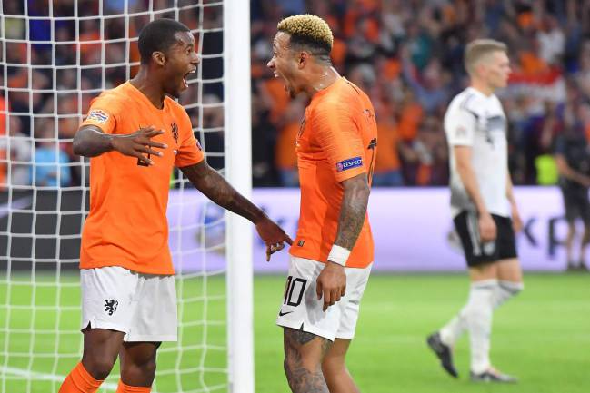 Added the icing | Netherlands' Georginio Wijnaldum celebrates with Memphis Depay.