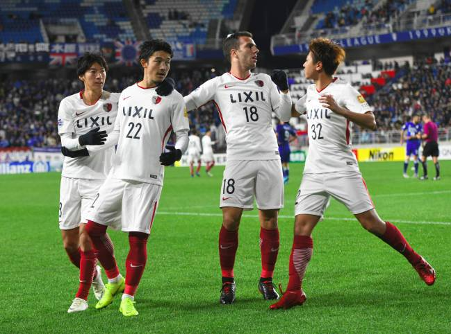 Kashima Antlers' Sergio Antonio Junior (2nd R) celebrates his goal with teammates.
