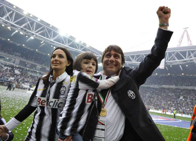 Juventus' coach Antonio Conte celebrates after winning their 28th Italian Serie A title.