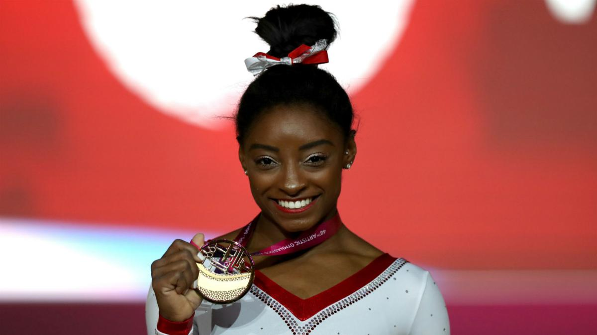 Brilliant Biles claims record 13th gold in Doha
