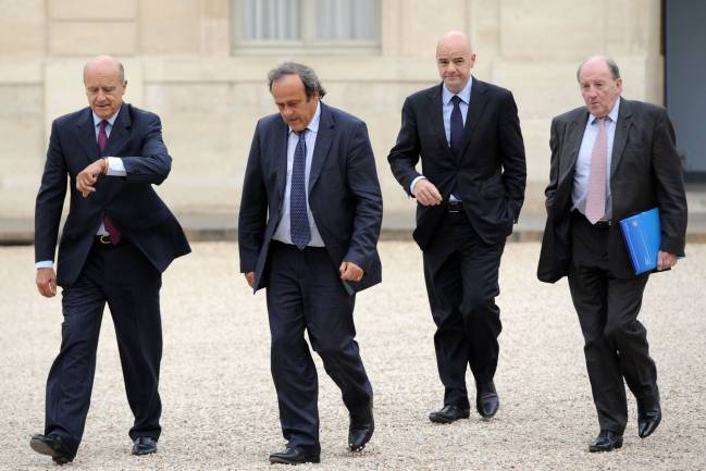Former French Prime Minister and current mayor of Bordeaux Alain Juppe (L) and UEFA President Michel Platini (C), followed by UEFA General Secretary Gianni Infantino and EURO 2016 President Jacques Lambert (R).