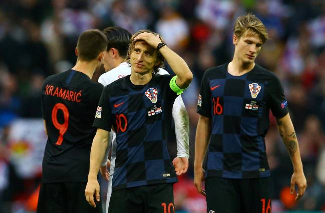 Relegated | Croatia's Luka Modric and Tin Jedvaj look dejected after the match against England