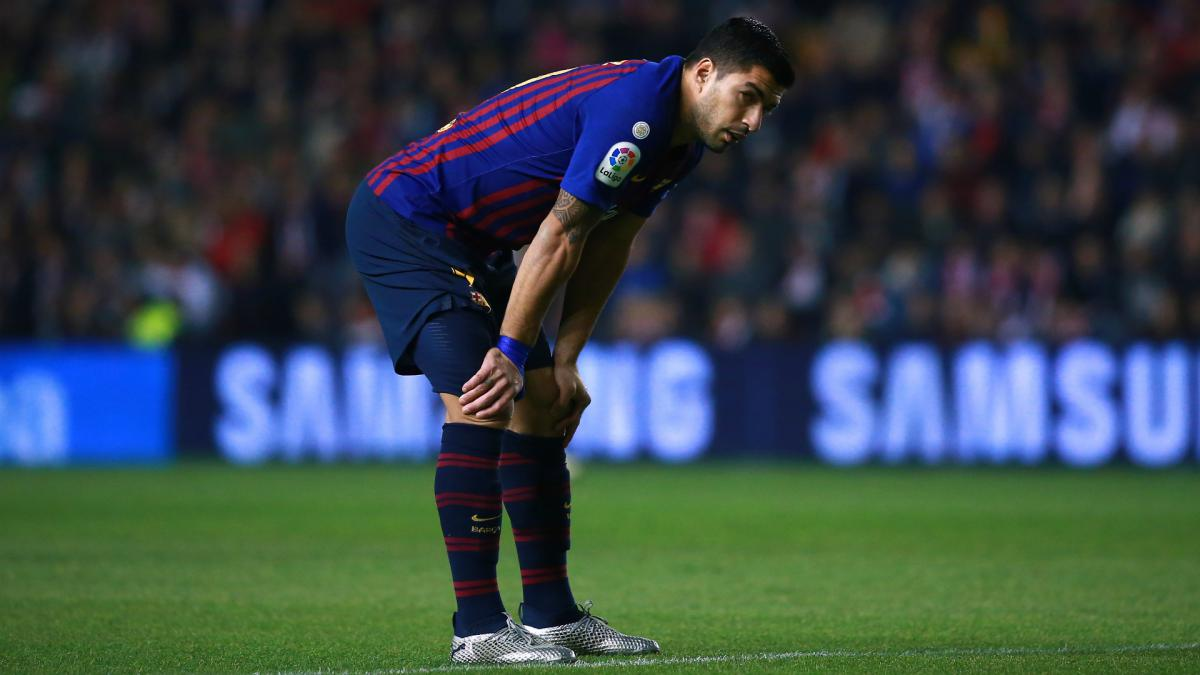 Suarez out for two weeks as Barcelona suffer treble injury blow