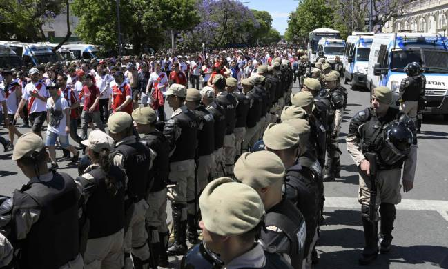 Security forces stand guard as River Plate's supporters leave the Monumental stadium in Buenos Aires.