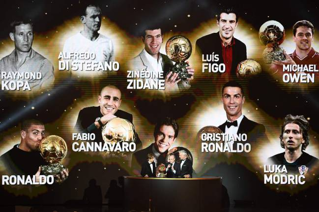 Luka Modric, Florentino Perez and David Ginola stand under a giant screen displaying famous Ballon d'Or awarded players.