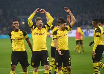 Dortmund survive derby test and stay on title course