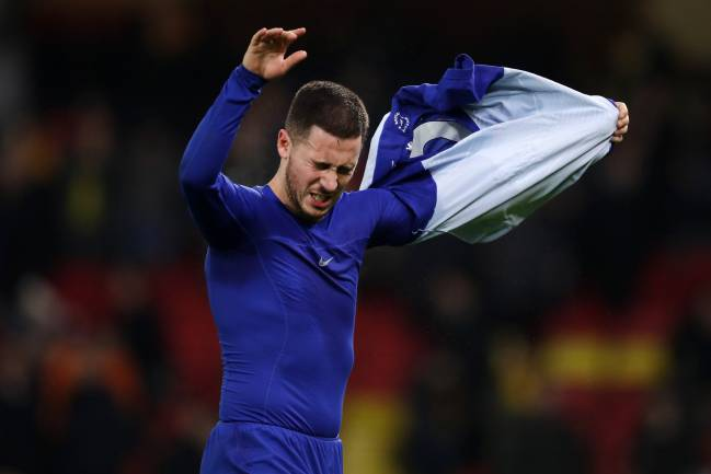 Eden Hazard of Chelsea throws his shirt to the fans following his side's victory in the Premier League match against Watford.