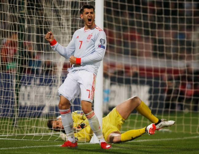 Monkey off! Spain's Alvaro Morata celebrates scoring against Malta.