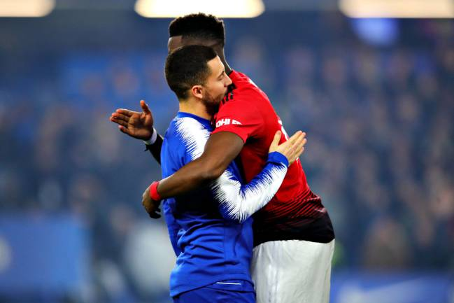 Real Mardrid linked | Paul Pogba of Manchester United hugs Eden Hazard of Chelsea.