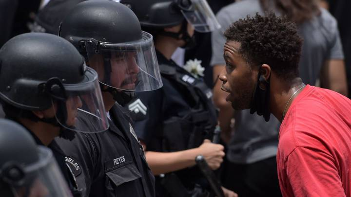 George Floyd protests: what does 'Defund the police' mean?