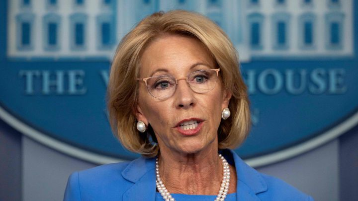 Why has Betsy DeVos submitted her resignation?